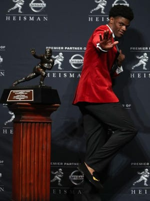 Lamar Jackson of the Louisville Cardinals poses for a photo after being named the 82nd Heisman Memorial Trophy Award winner during the 2016 Heisman Trophy Presentation at the Marriott Marquis on Saturday in New York City.
