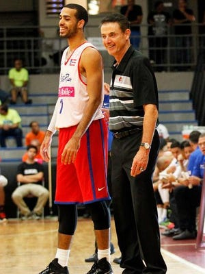 U of L's Rick Pitino has a laugh with a Puerto Rico player during Cards' recent weeklong trip.