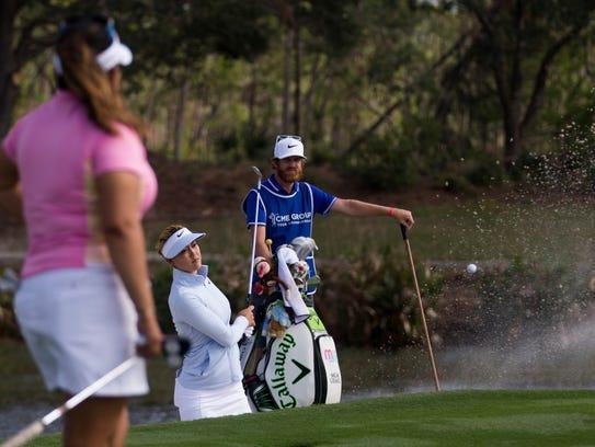 LPGA tour pro Michelle Wie hits out of a sand trap