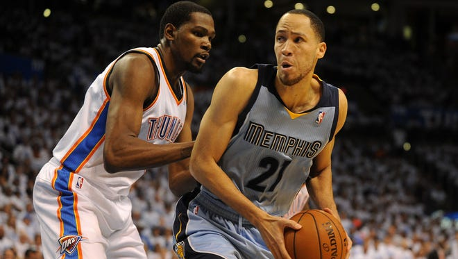 Memphis Grizzlies forward Tayshaun Prince (21) dribbles the ball as Oklahoma City Thunder forward Kevin Durant (35) defends during the second quarter in game five.