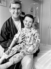 Ken Castleberry holds his 5-year-old son Glenn at his