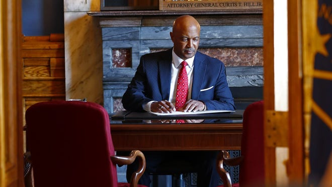 Indiana Attorney General Curtis Hill prepares to address the news media on Monday.