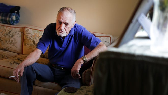Richard Mason, 77, of Clinton Township, sits in his living room Tuesday, June 14, 2016, talking about his companion Mary Potter, 71, who died in February 2014.