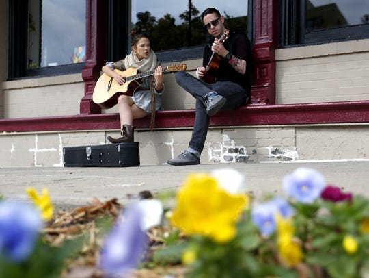 "Springfield native and actor Cailee Spaeny plays Jane Ginsburg, daughter of Supreme Court Justice Ruth Bader Ginsburg, in ""On the Basis of Sex,"" due out Decc. 25, 2018. Here Spaeny strums the guitar and sings with Doug Braudway as he plays the ukulele in downtown Springfield on Oct. 5, 2015."