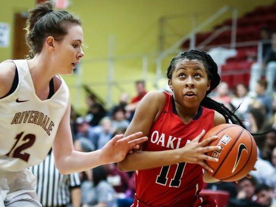 Oakland's Charlotte Livingston drives to the basket