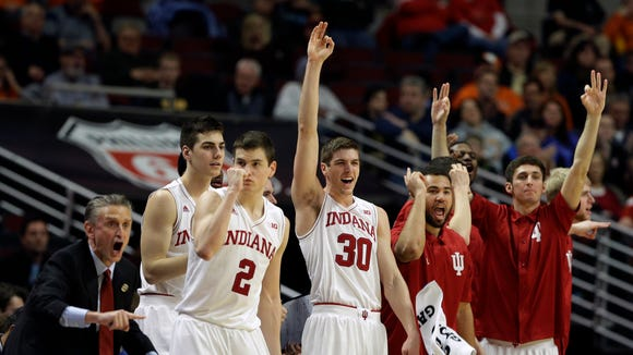 Indiana players react on the bench in the second half of an NCAA college basketball game against Northwestern in the second round of the Big Ten Conference tournament, Thursday, March 12, 2015, in Chicago. Indiana won 71-56.