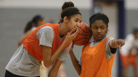 Blackman senior Crystal Dangerfield, right, points out something to senior teammate Jazz Bond. The two are four-year starters for the Lady Blaze.