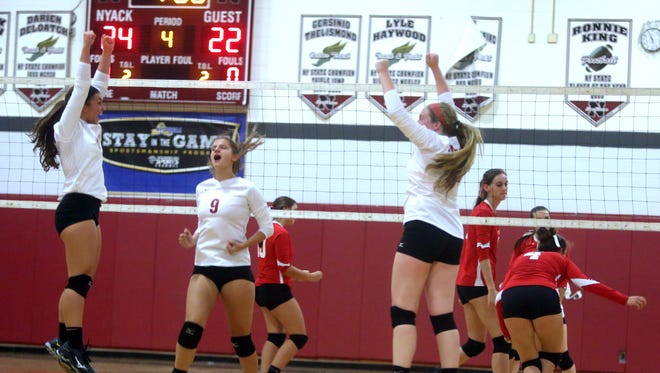 Nyack celebrates after defeating Tappan Zee in three straight games during a varsity volleyball match at Nyack High School Oct. 6, 2016. Nyack defeated Tappan Zee 25-12; 25-19; 25-22.
