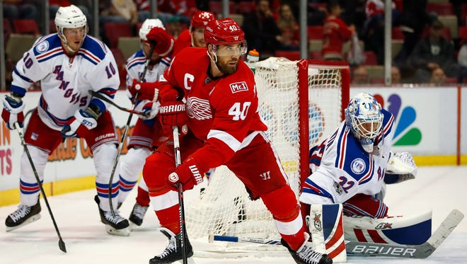 Red Wings captain Henrik Zetterberg looks to make a play in front of Rangers goalie Antti Raanta during the third period of the Wings' 4-1 loss Sunday, March 12, 2017 at Joe Louis Arena.