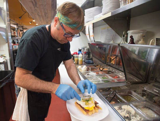 Erik Rohman, co-owner of The Waffle Lab, prepares a