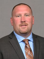 Tim Polasek will become Iowa's offensive line coach.