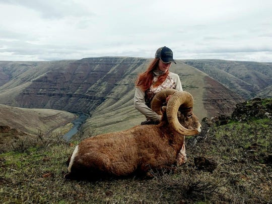 Kelly Zurbuch drew a rare California Bighorn tag in Oregon on her first try. The new hunter is seen here with her prize.