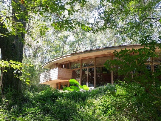 Spring House wooded side view