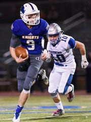 O'Gorman quarterback Isaac Struck (9) runs the ball while being chased by Rapid City Stevens defensive back Jamin Wurtz (10) during the first half of their high school football game on Friday, Oct. 13, 2017 at McEneaneyField in Sioux Falls.