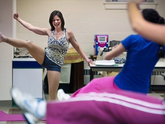 Personal trainer Lindsay Schultz leads her Ballet Body Sculpt class. Schultz said the class accommodates all fitness levels and that people don t need dance experience to participate. (Daily Record/Sunday News -- Paul Kuehnel)