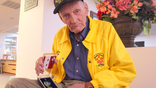 Local WWII Veteran Floyd Ryan wears his Honor Flight jacket and shows his Distinguished Service Award medal upon arriving home from a visit to Washington D.C. The trip was paid for by Honor Flight of Southern New Mexico, an organization helping older veterans visit the nation's capital to witness the country's most proud monuments.