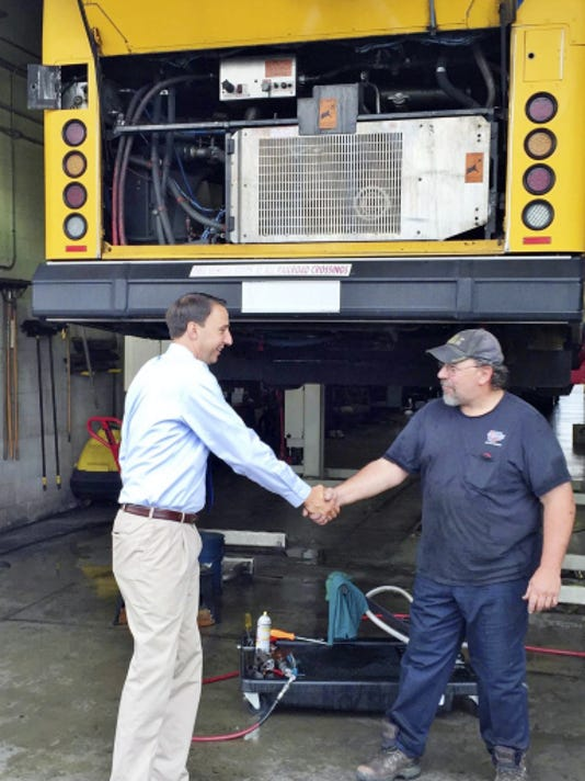 Congressman Ryan Costello shakes hands with Lebanon Transit mechanic Kirk Hibshman during a tour of LT's facility in Lebanon on Friday. John Latimer -- Lebanon Daily News