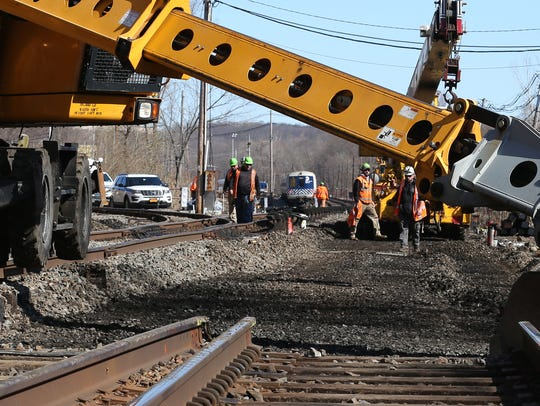 Metro-North Railroad workers replace track along the