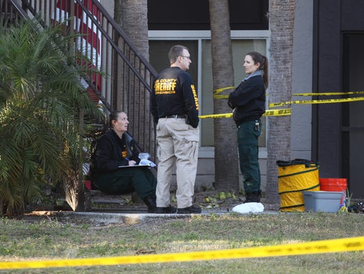 Members of the Lee County Sheriff's Office work the
