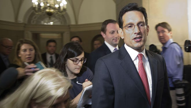 House Majority Leader Eric Cantor, R-Va., talks with reporters as he departs the Capitol on Oct. 15.