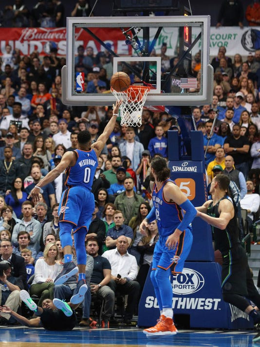 Oklahoma City Thunder guard Russell Westbrook (0) shoots against the Dallas Mavericks during overtime in an NBA basketball game Wednesday, Feb. 28, 2018, in Dallas. (AP Photo/Richard W. Rodriguez)