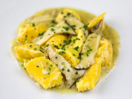 House-made ricotta agnolotti with winter truffle conserve from Maple & Ash in Chicago.