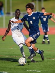 Essex's Dominic Minadeo, right, dribbles past Burlington's