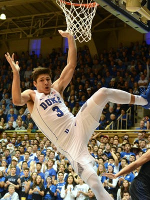 Duke Blue Devils guard Grayson Allen (3) tumbles after being fouled.