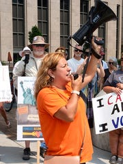 Cindy Garcia, of Lincoln Park, speaks to the crowd