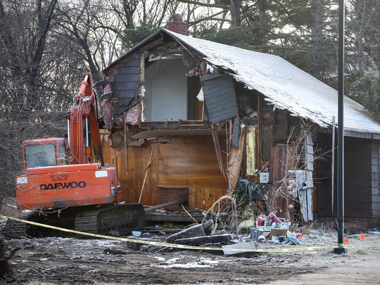 Demolition is underway Monday, Dec. 5, on a house on