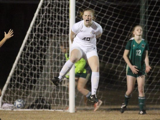 Leon's Kate Carter (40) reacts to scoring a header