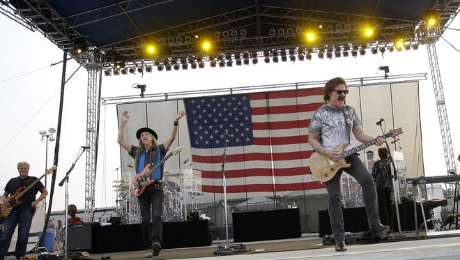 Doobie Brothers perform at Red White and Blue Ash at Summit Park, Saturday, July 4, 2015.