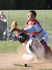 Kewaunee's Cody Bultman slides under the tag of Southern