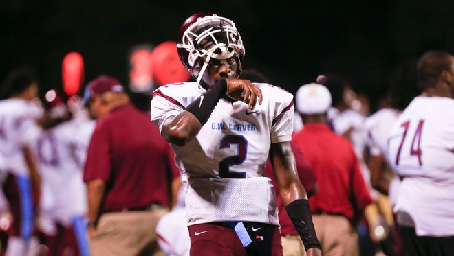 Columbus Carver quarterback and Louisville commit Jawon Pass wasn't happy late in the the game against Creekside High in Fairburn, Georgia. Pass would go on to complete 15 of 29 passes 211 yards and two touchdowns with three interceptions. He also ran for a 1-yard TD in the 51-20 loss to the Seminoles. Sept. 5, 2015