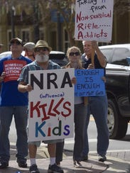Demonstrators rally outside Congressman Matt Gaetz's office in downtown Pensacola on Tuesday, Feb. 20, 2018, in support of gun control. The protest comes in the wake of last week's school shooting in Parkland.