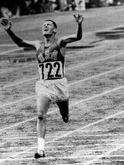 U.S. Marine Lt. Billy Mills pulls off a stunning upset by winning the 10,000 meters Olympic race in Tokyo Oct. 14, 1964.  Mills set an Olympic record 0f 28:24:4, and was the only American ever to win the event. (AP Photo)
