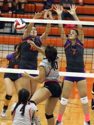 Andrea Aguilar, 10, left, and Marlo Salazar 7, of Eastlake rise to block a shot from Kailone Turner, center, of Hanks on Tuesday night at Eastlake.