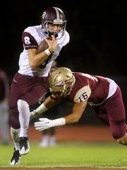 Bearden's quarterback Collin Ironside (8) runs the