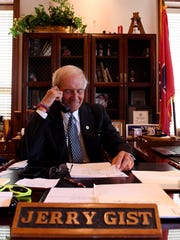 Jackson City Mayor Jerry Gist makes a phone call in