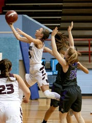 Bowie's Kamryn Cantwell drives between two Chisholm