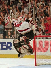 New Jersey Devils goalie Martin Brodeur reacts after