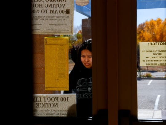 Autumn Mike looks over a sample ballot Tuesday at the San Juan Chapter house in Lower Fruitland.