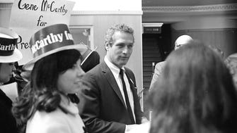 Paul Newman takes a break while making a campaign appearance for Eugene McCarthy at Milwaukee's Alverno College on March 21, 1968.