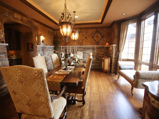 This is the dining room of this Northville home located at 48090 Ravello Court.