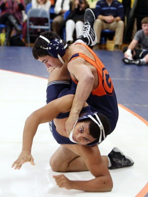 Greeley's Aaron Wolk defeated Suffern's Darren Marte in the 170-pound weight class during wrestling action at Horace Greeley High School in Chappaqua Dec. 20, 2016.