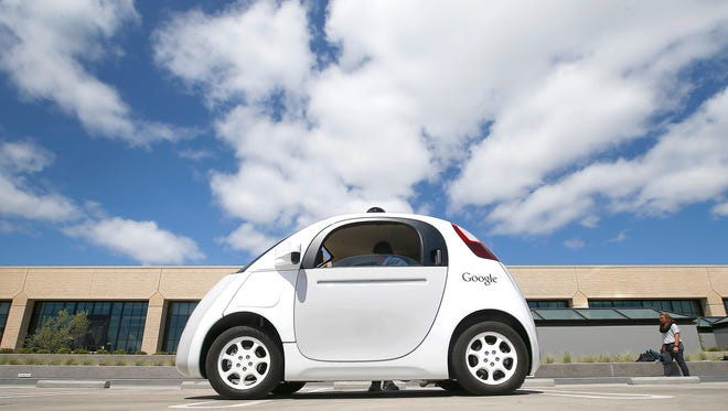 In this May 13, 2015, file photo, Google's new self-driving prototype car is presented during a demonstration at the Google campus in Mountain View, Calif.