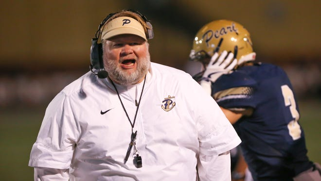 Pearl head football coach John Perry yells instructions to his team in the second half. Pearl and Hancock played in an MHSAA Class 6A playoff game on Friday, November 17, 2017 at Pearl High School. Photo by Keith Warren