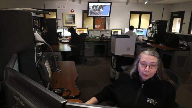 Supervisor Wendy Maechtle works at one of four communications consoles in the Ozaukee County Sheriff's Department's Dispatch Center. Cedarburg is exploring the possibility of contracting its dispatching services from the sheriff's department.