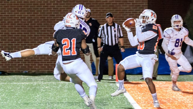 Mercer's Kam Lott (20) intercepts a pass in the end zone with 3 seconds left to seal the win over Furman.