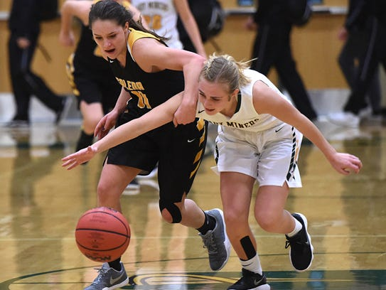 Galena's Taylor Crofoot, left, and Manogue's Kenna Holt battle for a loose ball at Bishop Manogue on Jan. 16.